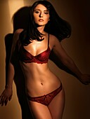 Beautiful young woman in red lingerie Artistic dynamic fashion glamour photo