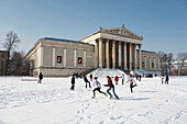 Children playing in front of State Collection of Antiques at Koenigsplatz, Munich, Bavaria, Germany