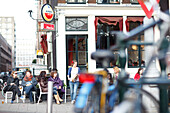 scene of people in front of street cafe in Amsterdam, Netherlands