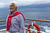 Actor Mario Adorf aboard the cruiseship MS Delphin, for the filming of the ARD film Die lange Welle hinterm Kiel, Aegean Sea, near Greece, Europe