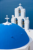 Blue dome of Greek Orthodox church & bell tower, Fira, Santorini, Greece, Europe