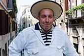 Cheerful gondolier, Gondolieri wearing traditional clothes, Venice, Veneto, Italy, Europe