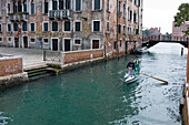 Racing gondola with two gondoliers on a channel, Venice, Veneto, Italy, Europe