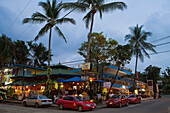 Taxis outside bars and restaurants at dusk, Manuel Antonio, Puntarenas, Costa Rica, Central America, America