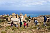 hiker to the Ruins on Capo d'Occi above Algajola village, North-west coast, Balagne region, Corsica, France, Europe