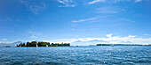 Panoramic view with Fraueninsel with Kampenwand  and Hochgern in the background, Chiemsee, Chiemgau, Upper Bavaria, Bavaria, Germany