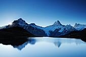 Sunrise above lake Bachsee with Wetterhorn, Lauteraarhorn, Schreckhorn and Finsteraarhorn, lake Bachsee, Grindelwald, UNESCO World Heritage Site Swiss Alps Jungfrau - Aletsch, Bernese Oberland, Bern, Switzerland, Europe