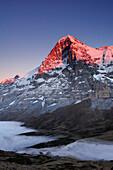 Alpenglow at Eiger above Kleine Scheidegg, sea of fog above Grindelwald, Kleine Scheidegg, Grindelwald, UNESCO World Heritage Site Swiss Alps Jungfrau - Aletsch, Bernese Oberland, Bern, Switzerland, Europe