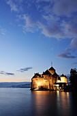 Illuminated castle Chillon at lake Geneva in the evening, lake Geneva, Lavaux Vineyard Terraces, UNESCO World Heritage Site Lavaux Vineyard Terraces, Vaud, Switzerland, Europe