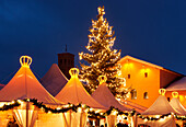 Christmas Fair with a Christmas tree in the evening, Crown Estate Bornstedt, Bornstedt Church, Potsdam, Brandenburg, Germany