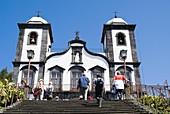 Church of Nossa Senhora MONTE MADEIRA Tourist climbing steps to Church of Our Lady