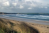 DUNNET BAY CAITHNESS Stormy waves breaking on sandy beach sand dunes
