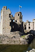Raglan Castle GWENT WALES Great tower moat ruins Welsh official flag green and white red dragon
