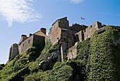 Mont Orgueil Castle ST MARTIN JERSEY Cliff face fortified castle battlements and buildings