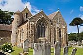St Brelades Bay ST BRELADE JERSEY St Brelade Parish church with round tower and gravestones