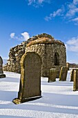 St Nicholas Church ORPHIR ORKNEY Round Kirk nave ruin and gravestone in snow