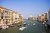 The Grand Canal showing Water Taxis and pleasure boats and typical Venetian architecture in Venice Italy