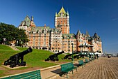 Old guns on the promenade in front of the Hotel Fairmont Le Château Frontenac Quebec City, Canada