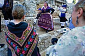 Zaragoza, Aragón, Spain: People with traditional costume on October 12 during the celebration of El Pilar in roman wall