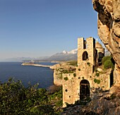 The 13th century Byzantine church of Odigitraea, known localy asAgitria,  set in a dramatic location In The Deep Mani, near Stavri, in the middle distance is the Tigani peninsula, with the Taygetos mountains in the background Southern Peloponnese, Greec