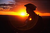 Tracey Weber mountain biking The Deadline Ridge Trail at sunset which is located high in The Goose Creek Mountains Idaho USA