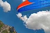 Elijah Weber landing after paragliding at Le Brevent in the Aiguilles Rouges high above the city of Chamonix France