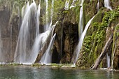 The Plitvice Lakes in the National Park Plitvicka Jezera in Croatia The upper lakes, ponds and waterfalls The Plitvice Lakes are a string of lakes connected by waterfalls They are in a valley, which becomes a canyon in the lower parts of the National P