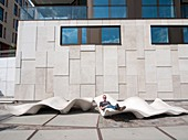 Modern sculpted concrete seating on promenade at Vasco Da Gamma Platz in new Hafencity property development in Hamburg Germany