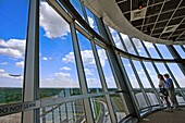Two people watch a jumbo jet land at Dulles international airport from the Smithsonian observation tower in Dulles, Virginia