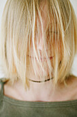 Girl (12 years) with hair covering face