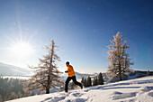 Man jogging in snow, Styria, Austria