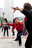 Dancer, couple, man and women, dance teacher in red shirt, group of dancers on a public square in front of the Walmart Shopping centre, many Chinese enjoy dancing in public, Shapingba District, skyscraper, Chongqing, People's Republic of China