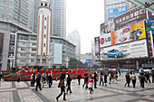 Public square in Chongqing, pedestrians, advertisment and skyscrapers, Chongqing, People's Republic of China