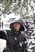 Snow-covered Beijing, man laughing, snow is rarely seen in Beijing, Beijing, People's Republic of China