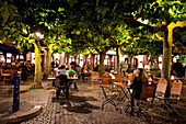 People at outdoor seating of restaurant at Schlossturm, Old town, Düsseldorf, Duesseldorf, North Rhine-Westphalia, Germany, Europe