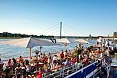 Restaurant on a ship at Rhine promenade in the sunlight, Düsseldorf, Duesseldorf, North Rhine-Westphalia, Germany, Europe