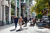 People in front of shops at Königsallee, Düsseldorf, Duesseldorf, North Rhine-Westphalia, Germany, Europe