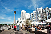 People and modern buildings under clouded sky, Neuer Zollhof, Frank O. Gehry, Media Harbour, Düsseldorf, Duesseldorf, North Rhine-Westphalia, Germany, Europe