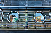 Reflection in round windows, Media Harbour, Düsseldorf, Duesseldorf, North Rhine-Westphalia, Germany, Europe