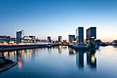 Buildings at Media Harbour at night, Düsseldorf, Duesseldorf, North Rhine-Westphalia, Germany, Europe