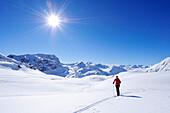 Woman backcountry skiing ascending towards Piz Surgonda, Julierpass, Albula range, Upper Engadin, Engadin, Grisons, Switzerland, Europe