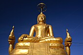 The seated brass Buddha in Subduing Mara, Phuket, Thailand
