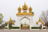 Ancient, Architecture, Art, Asia, Buddhism, Building, Color, Colour, Day, Daylight, Daytime, Gate, Gateway, Golden, Holy, Horizontal, Lao, Laos, Monument, National, Outdoor, Pha That Luang, Religion, Stupa, Symbol, Temple, Tourism, Touristic, Travel, Vien