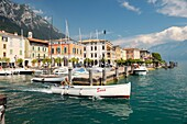 The holiday resort town of Gargnano on Lake Garda, Lombardy, Italy Boat leaving the harbour Lago di Garda