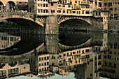 Florence, Tuscany, Italy The Ponte Vecchio old bridge across the River Arno in the heart of the mediaeval renaissance city