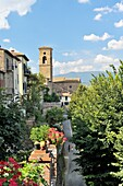 The hill top town of Poppi, Tuscany, Italy A steep street climbs to the mediaeval Abbey of San Fedele