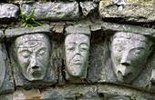 Carved stone human and animal heads on Romanesque door arch of ancient monastic church at Dysert O'Dea, County Clare, Ireland