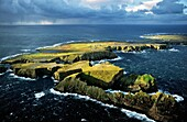Tory Island, Co Donegal, Ireland Celtic Balor's Fort on flat top peninsula Hut circles, defence ditch and rampart visible