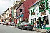 Dingle, west Kerry, famous for its pubs, music and relaxed atmosphere Young men and women on the main street