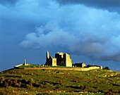 Mediaeval cathedral, round tower and Cormac's Chapel sit on the Rock of Cashel, County Tipperary, Ireland Sunset after rain
